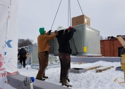 Hoisting rooftop units on to Jukes ales works