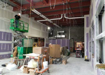 piping in fan coils at skutt catholic for new main entrance